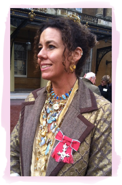 For services to ethical jewelry, Pippa Small was made a Member of the British Empire (M.B.E). by Queen Elizabeth in November, 2013. Wearing a marvelous mash-up of multiple necklaces and earrings that she designed, Pippa sports her beribboned medal of honor. Congratulations and more power to you, Pippa! Photo courtesy Pippa Small.