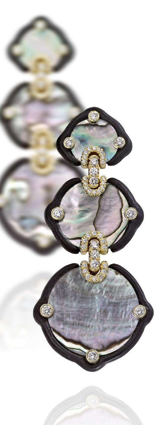 "Known for selecting richly colored seashells in his jewelry, Nicholas Varney's ""Abalone Slice"" earrings are a triple treat of 18K gold, ebony, diamonds and iridescent abalone shell."
