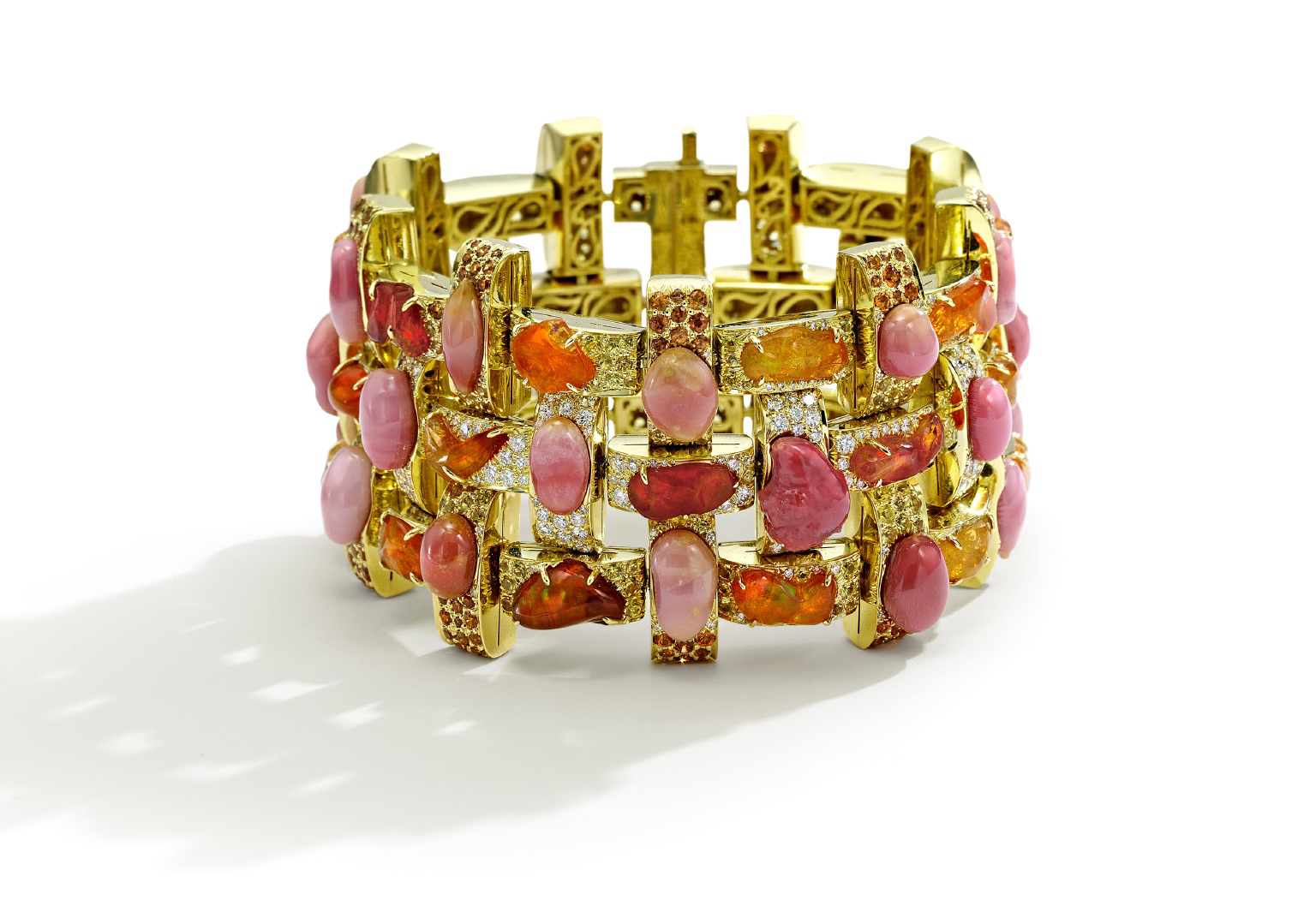 Boca Grande Bracelet Glowing in rich sunset hues, this Nicholas Varney18K gold bracelet features luminous pink conch pearls, blazing orange fire opals, diamonds and yellow sapphires. Note the gracefully designed 18K gold grille on the underside.